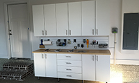 Classic white cabinets with maple butcher block counter