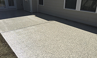 A floor coating on an outdoor patio will make cleaning it a breeze.